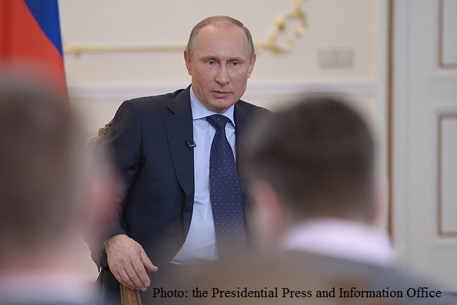 Russian President Vladimir Putin speaks to the Press