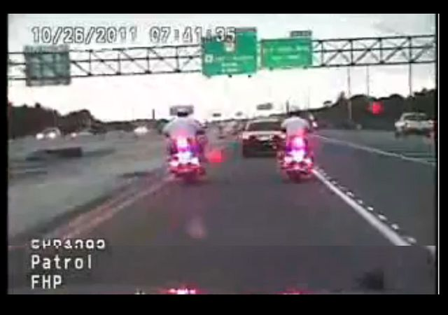 Safety first; stay alert. FHP motorcycle cop goes down hard
