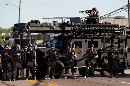 TANKS AND GRENADE LAUNCHERS? WHY ARE POLICE STOCKING UP ON MILITARY GEAR?