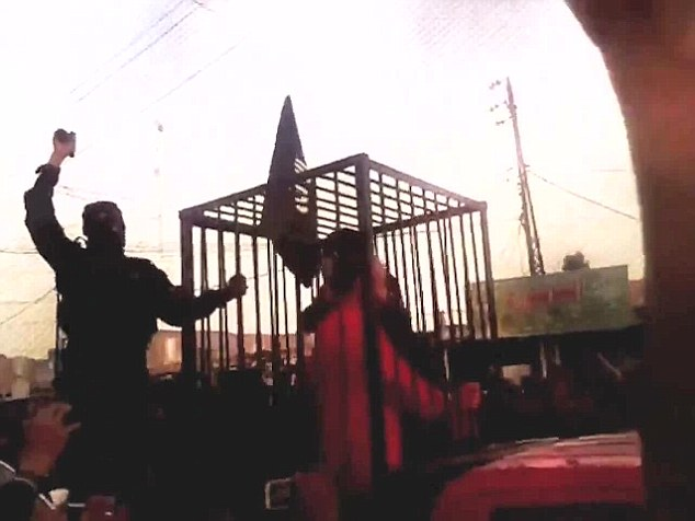 [Watch] Horrifying! ISIS Parades 17 Kurdish Fighters Through the Streets in Cages to be 'Burned Alive!'