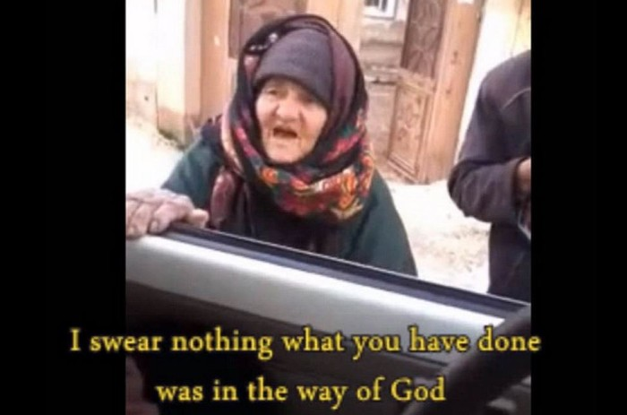 [Watch] Elderly Woman Stands Up to ISIS Militants Saying 'You Are Devils' and 'ISIS is Cursed'