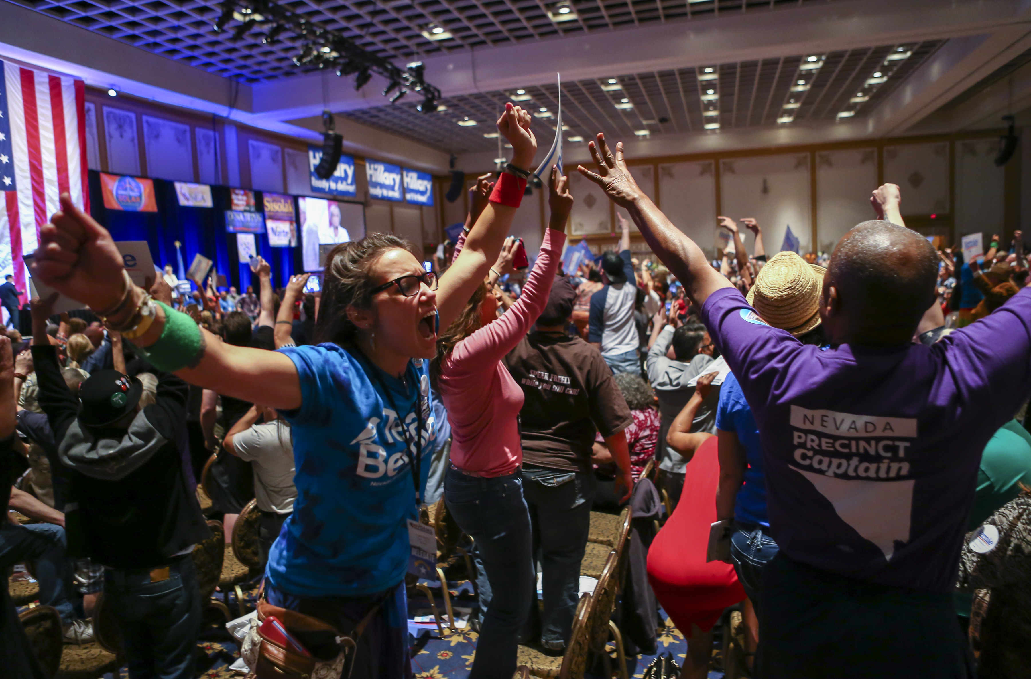 In a Saturday, May 14, 2016 photo, supporters of Democratic presidential candidate Bernie Sanders react during the Nevada State Democratic Party's 2016 State Convention at the Paris hotel-casino in Las Vegas. The Nevada Democratic Convention turned into an unruly and unpredictable event, after tension with organizers led to some Bernie Sanders supporters throwing chairs and to security clearing the room, organizers said. (Chase Stevens/Las Vegas Review-Journal via AP) LOCAL TELEVISION OUT; LOCAL INTERNET OUT; LAS VEGAS SUN OUT