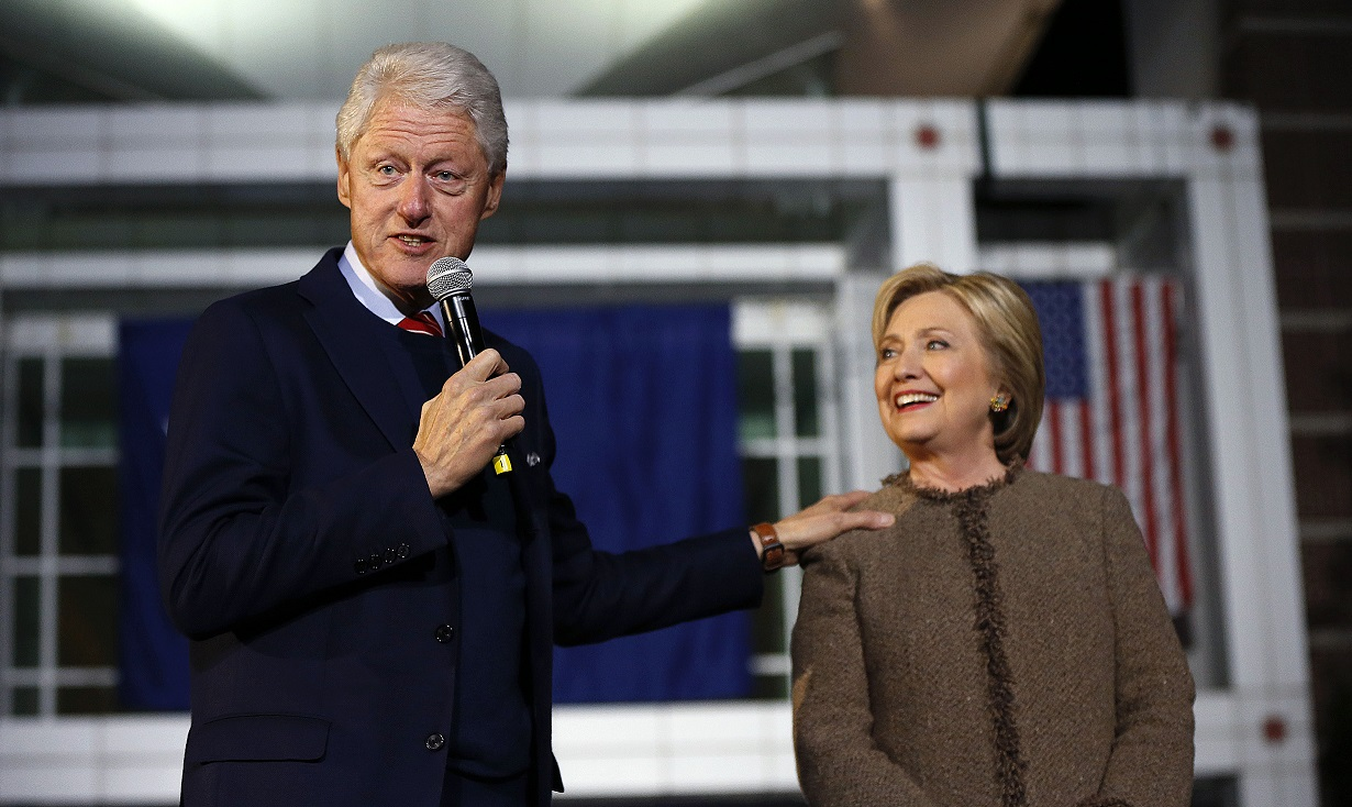 """Democratic presidential candidate Hillary Clinton and her husband, former President Bill Clinton, speak at a """"Get Out The Vote Rally"""" in Columbia, S.C., Friday, Feb. 26, 2016. (AP Photo/Gerald Herbert) ORG XMIT: SCGH122"""