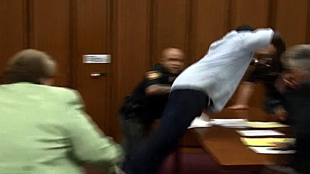 Dan Attacks Daughter's Killer In Court (Video)