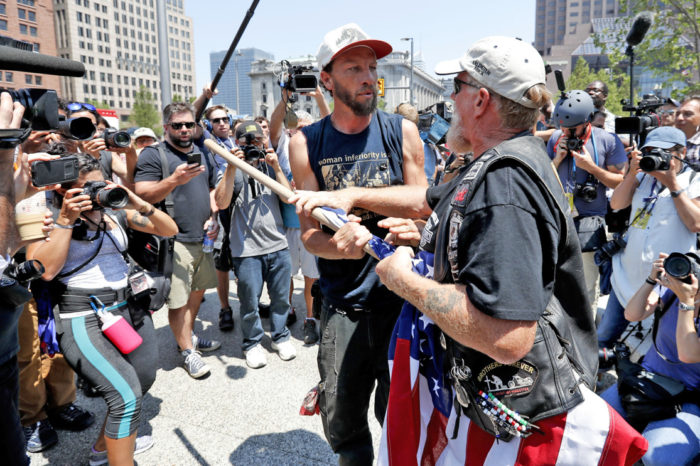 Black Lives Matter Supporters, KKK, Westboro Clash Outside RNC, Throw Urine At Each Other