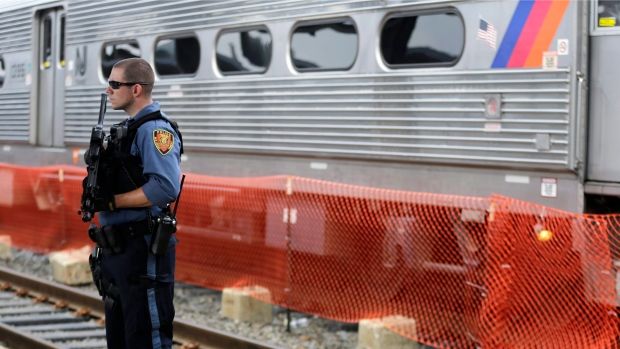 Watch A Police Officer Pull A Man Off Train Tracks With Just Seconds To Spare (Video)