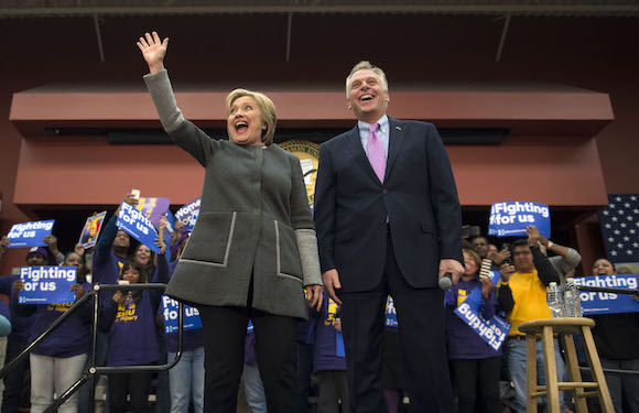 Democratic presidential candidate Hillary Clinton is introduced by Virginia Governor Terry McAuliffe at a campaign event at George Mason University in Fairfax, Va., Monday, Feb. 29, 2016. (AP Photo/Molly Riley)