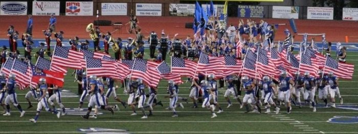 EPIC! Entire High School Football Team Runs onto Field Waving American Flags! (Video)