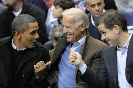 File photo of Obama, Biden and Biden's son Hunter attending an NCAA basketball game between Georgetown University and Duke University in Washington