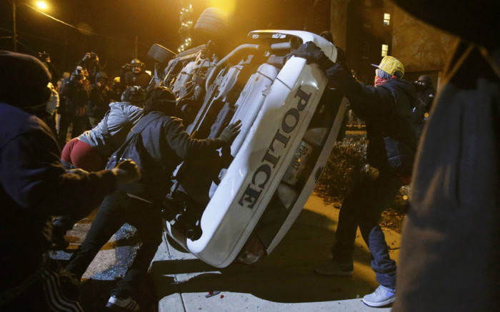 DOJ Reports Fault Ferguson Police-Cost More Than $1M
