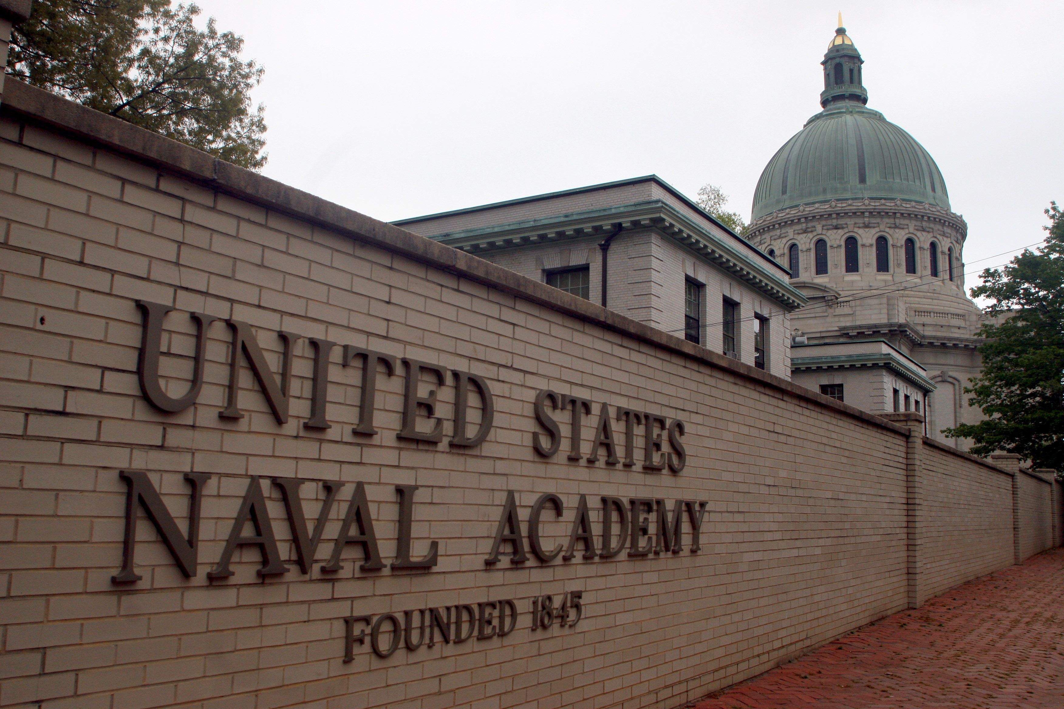 "FILE - This is a May 7, 2007 file photo showing the United States Naval Academy in Annapolis, Md. The U.S. Naval Academy is investigating allegations that three members of its football team sexually assaulted a female midshipman at an off-campus house last year, a Pentagon spokesman said Friday, May 31, 2013, and a lawyer for the woman says she was ""ostracized"" on campus after she reported it. (AP Photo/Kathleen Lange, File)"