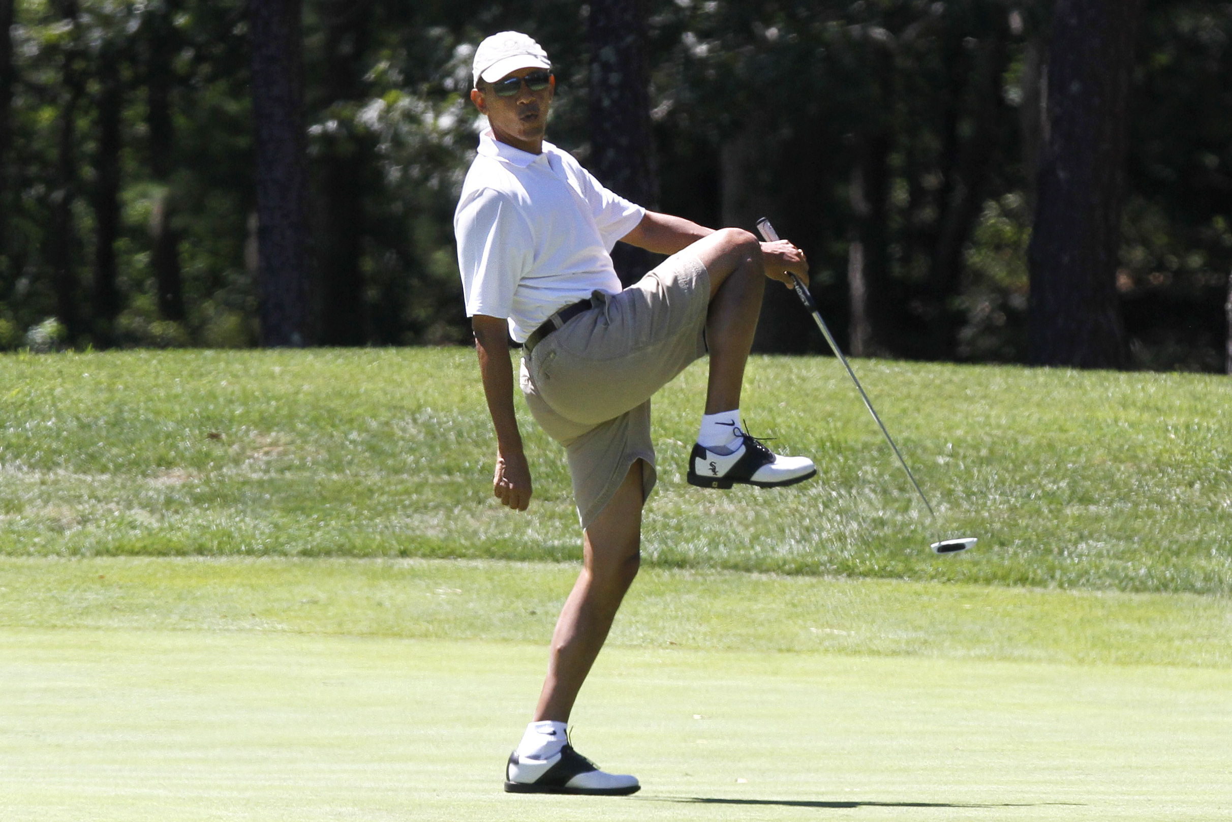 President Barack Obama reacts as he misses a shot while golfing on the first hole at Farm Neck Golf Club in Oak Bluffs, Mass., on the island of Martha's Vineyard on Sunday, Aug. 11, 2013. (AP Photo/Jacquelyn Martin)