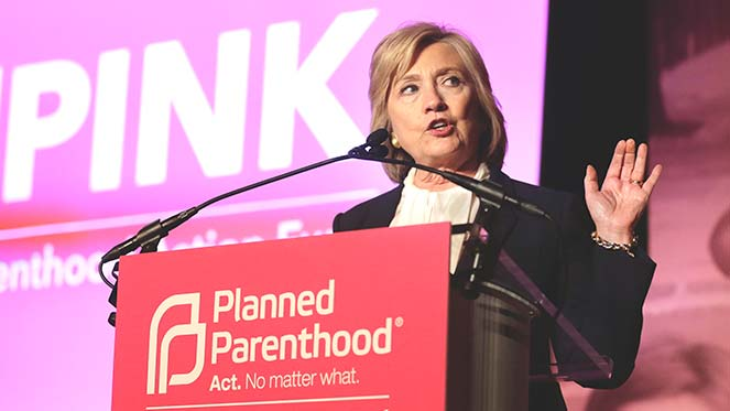 Democratic presidential candidate Hillary Clinton addresses an audience during an event Sunday, Jan. 10, 2016, in Hooksett, N.H., during which Planned Parenthood endorsed Clinton in the presidential race. The endorsement by the group's political arm marks Planned Parenthood's first time wading into a presidential primary. (AP Photo/Steven Senne)