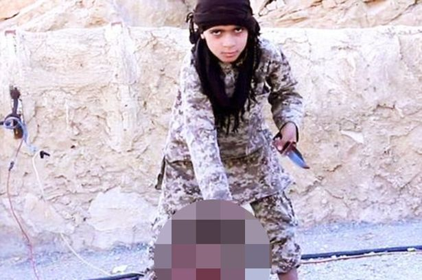 ISIS Releases Chilling Video Of English-Speaking Child Beheading Hostage And Threatening America