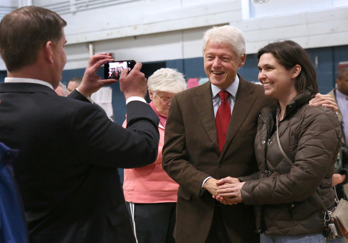 (Boston, MA - 3/1/16) Mayor Martin Walsh uses a woman's cellphone to take a photo of her with former President Bill Clinton during a visit to Holy Name Elementary School in West Roxbury, Tuesday, March 01, 2016. Staff photo by Angela Rowlings.