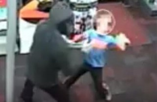 Little Boy Wails Punches At Armed Gunman Robbing GameStop Store (Video)