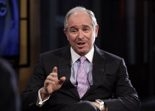 "Blackstone Group CEO Stephen Schwarzman is interviewed by Maria Bartiromo during her ""Opening Bell with Maria Bartiromo"" program, on the Fox Business Network, in New York, Thursday, Feb. 27, 2014. (AP Photo/Richard Drew)"