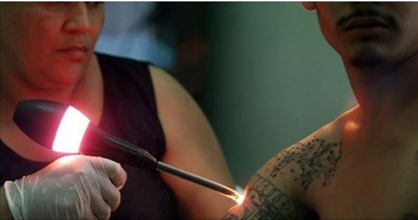 Immigrants Hurry To Remove Tattoos Fearing ICE Will Tie Them To Gangs