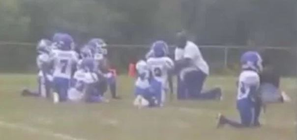 DISGRACEFUL! 8-Year-Old Football Team and Coach Take a Knee During National Anthem (Video)